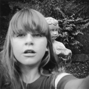 A young girl in the 1970s photographs herself.